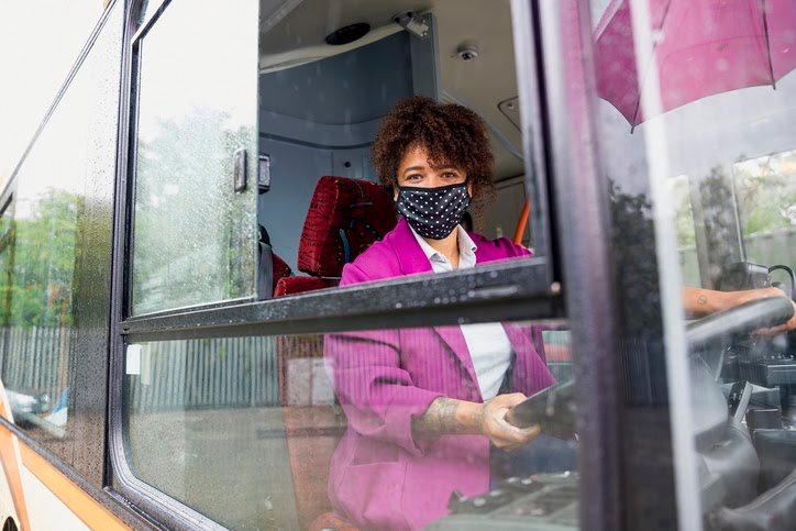 Public transport worker wearing a face mask and working during the Covid crisis.