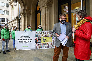 """A Dinosaur Mosaic to """"ROAR"""" against Luxembourg's Pension Fund Investments in Fossil Fuels. © Lise Bockler / Greenpeace"""