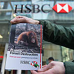Greenpeace deliver leaflets to HSBC staff and customers making them aware that the bank is funding rainforest destruction in Indonesia.