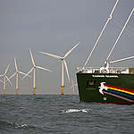 The new Rainbow Warrior sails past the Princess Amalia wind farm, 12 miles from the coast of IJmuiden. The park consists of 60 windmills which are able to supply 125,000 homes with clean energy. As the flagship's maiden voyage continues from Hamburg to Amsterdam.