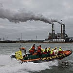 """Fourteen Greenpeace activists try to stop a fully loaded party boat from mooring at the E.ON coal-fired power plant at the Maasvlakte. The E.ON guests are on their way to the opening of the experiment with Carbon Capture and Storage (CCS). The banner on their boat reads """"E.ON Stop Kolen"""", which translates to English as """"E.ON Quit Coal"""".  They want to stop the CO2 dumping. Veertien actievoerders van Greenpeace verhinderen het aanmeren van een partyboot vol gasten bij de kolencentrale van energiebedrijf E.ON op de Maasvlakte. De gasten van E.ON zijn op weg naar de opening van het experiment met afvang van CO2. Op het spandoek staat """"E.ON Stop Kolen"""". Zij willen de CO2-afvang stoppen."""