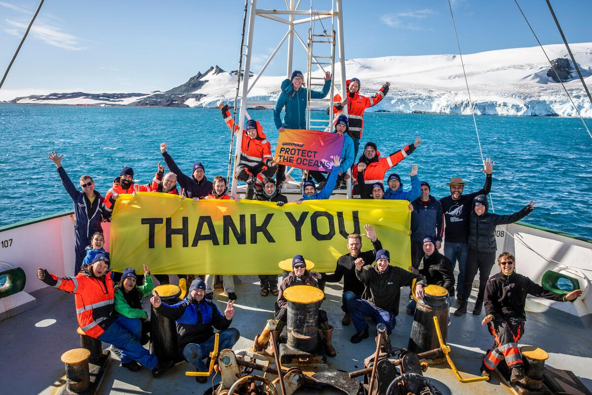 Crew of MY Esperanza in Antarctica. © Andrew McConnell / Greenpeace