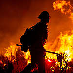 A firefighter battles the Bobcat Fire as it surpasses 100,000 acres on the evening of September 20, 2020 near Wrightwood, California. The fire has burned across a large percentage of the Angeles National Forest and threatened the historic observatories on Mount Wilson.   The Bobcat fire is one of the largest wildfires in Los Angeles County history.