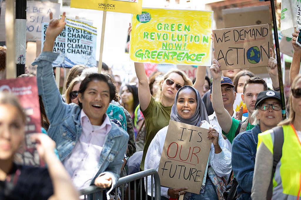 Mensen komen in actie tegen de opwarming van de aarde. © Suzanne Plunkett / Greenpeace
