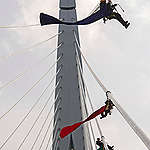 Four activists from Greenpeace Netherlands climb the Erasmus Bridge in Rotterdam