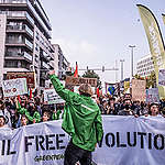 More than 50.000 people take to the streets in Brussels for the first Climate march since the COVID-19 crisis hit. During the march Greenpeace Belgium organises an action against fossil fuel advertisements, to raise awareness on the European Citizenship Initiative.