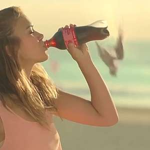 Greenpeace challenges Coke with Christmas ads