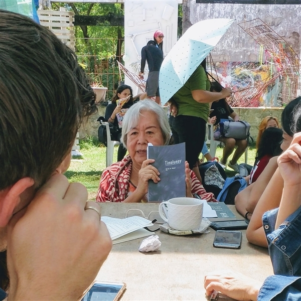 """Merle. M. Alunan reads from her edited Waray collection, """"Tinalunay"""". © Greenpeace / Amrekha Sharma"""