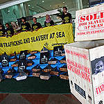 Activists stands during the protest in front of  the Ministry of Manpower, Jakarta. The Indonesian Migrant Workers Union (SBMI) and Greenpeace Indonesia held a peaceful protest to urge improvement for placement policies and protection of migrant worker crews from Indonesia working on foreign fishing vessels outside the country. The protest was held one day before the commemoration of International Human Rights Day which is celebrated on 10 December.
