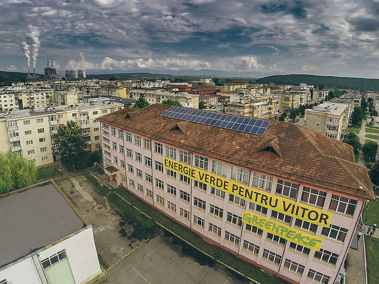 Installation of Solar Panels on School Rooftop in Romania. © Cristian Grecu / Greenpeace