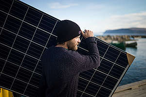 Unloading Solar Panels in Clyde River. © Greenpeace