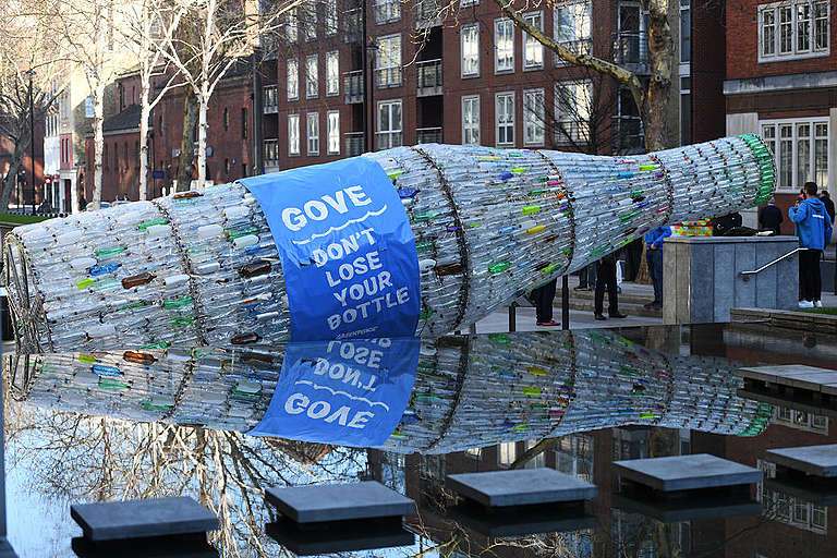 Giant Plastic Bottle for Michael Gove in London. © David Mirzoeff / Greenpeace