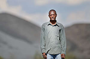 Local Activist at Informal Settlement in South Africa. © Mujahid Safodien / Greenpeace