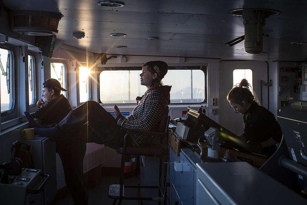Crew on MY Esperanza in Svalbard. © Will Rose / Greenpeace