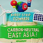 Celebration Cake for East Asia's G3 Countries going Carbon-Neutral. © Greenpeace