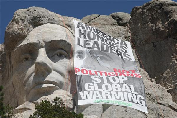 Greenpeace climbers rappel down the face of Mount Rushmore in 2009  to unfurl a banner challenging President Obama to lead on global warming.