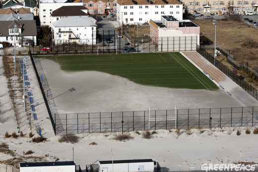 Sand from Hurricane Sandy still obscures most of an athletic field in the Rockaway section of Queens, New York