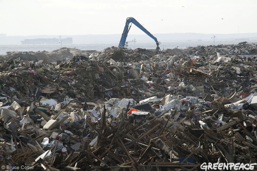 Heavy equipment piles rubble being collected in a makeshift garbage dump in Jacob Riis Park in Rockaway, Queens,