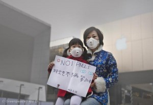 A girl and her mother wear respirator masks in Beijing.