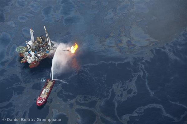 Boats try unsuccessfully to clean oil from the ocean, near the site of the Deepwater Horizon disaster.