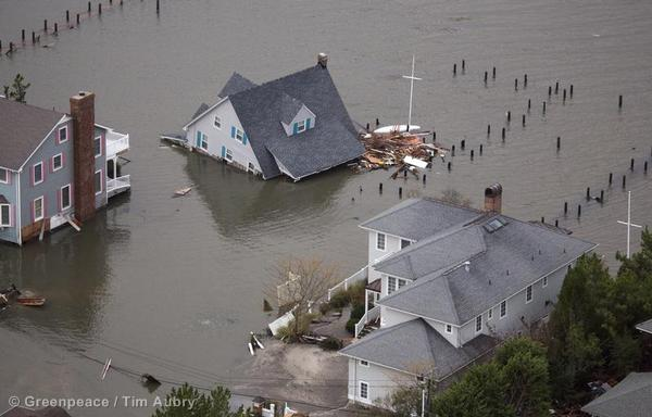 A building collapsed into floodwater near the Route 528 (Herbert Street) Bridge one day after Hurricane Sandy hit the New Jersey and New York.