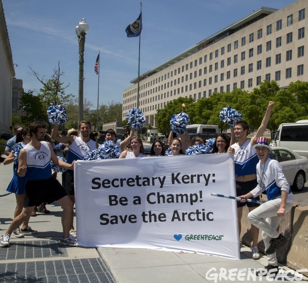 Greenpeace marching band and cheerleader activists help call attention to the threat the Arctic faces from climate change and off-shore drilling during a visit to the State Department