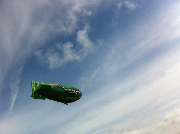 Greenpeace's thermal airship, A.E. Bates, flies over Seattle, a fishing industry hub, to call attention for Bering Sea protection.