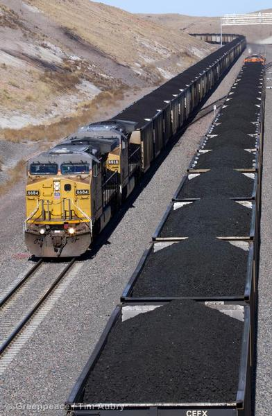 Coal trains pass each other in Campbell County. Coal trains are typically a mile long with 100 tons of coal in each of the 100 - 120 cars of the unit train.