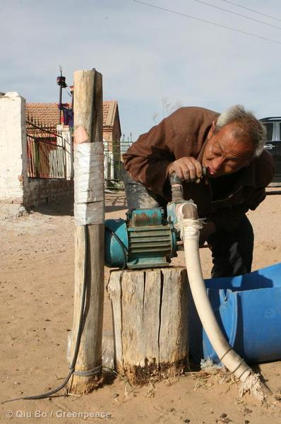 Lin Bo in attempts to get some drinking water from his dry well.