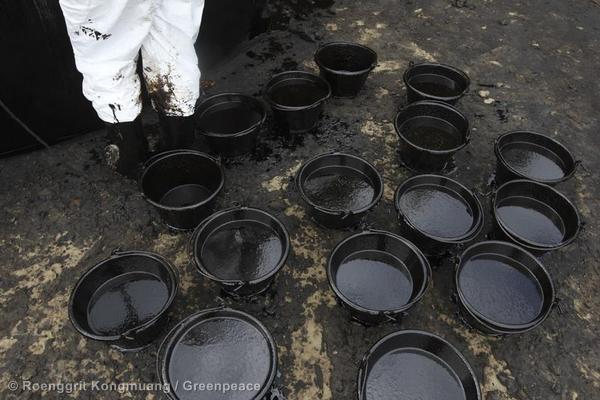 Black oil in pails collected from the shore that spilled through Ao Phrao beach in Ko Samed, Rayong Province.