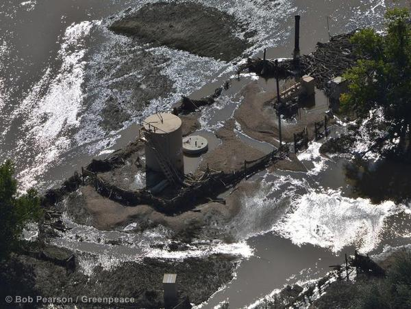 Flood waters recede from an oil operation by the South Platte River near Greeley