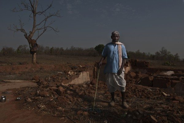 Jeetlal Baiga in the Sasan Moher block forest area, stands near his broken down home, from where his family was displaced by the Sasan coal mine project