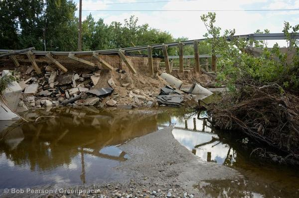 Portions of a bridge remain standing after flood waters from the St. Vrain River washed through Longmont.