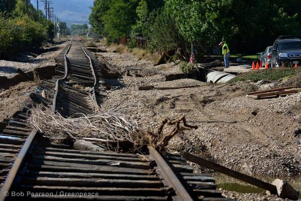A section of rail line is twisted and damaged following recent floods in Longmont.
