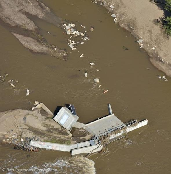 Debris lies in the riverbed of the South Platte River