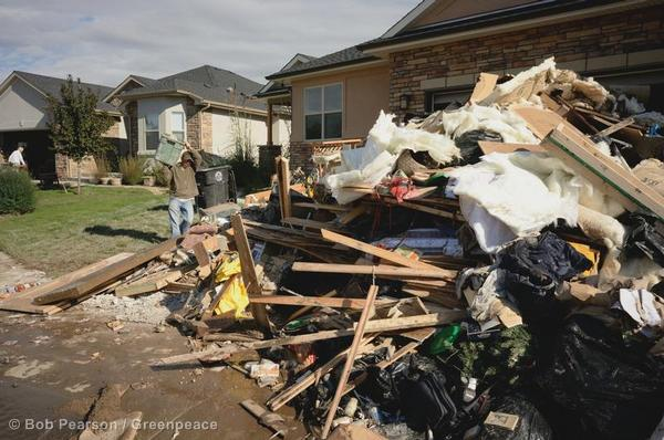 Residents clear their houses of debris