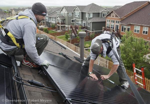 A solar panel installation on a rooftop in Aurora, CO.