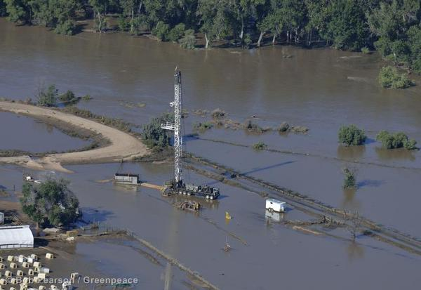 An oil operation remains under water by a washed-out rail line on the South Platte River near Greeley