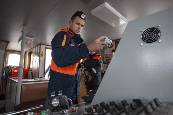 Russian authorities illegally boarding the Greenpeace ship Arctic Sunrise.