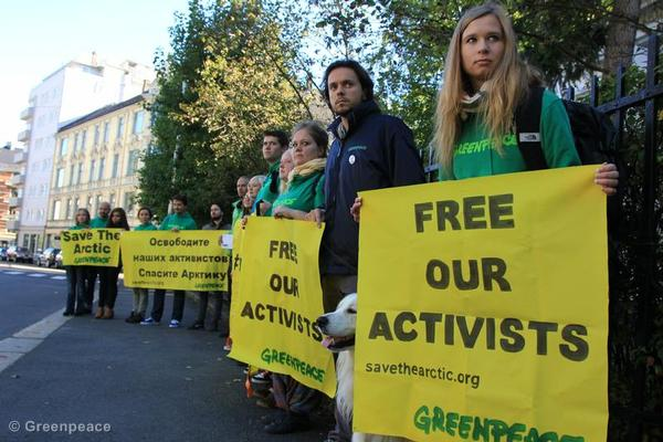 Greenpeace activists protest outside the Russian embassy in Oslo.