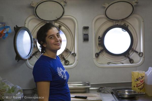 Crew member Gizem Akhan at work in the kitchen of the Arctic Sunrise.