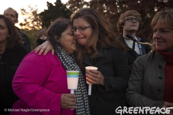 Bani Daniell, left of center, is hugged by her niece Natasha Willcox