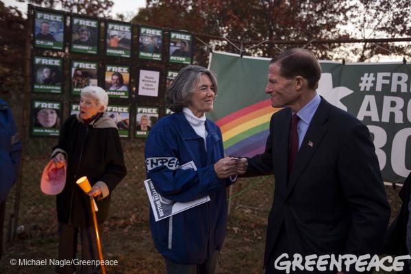 Maggy Willcox, center, talks with United States Senator Richard Blumenthal at a vigil in Norwalk, Conn