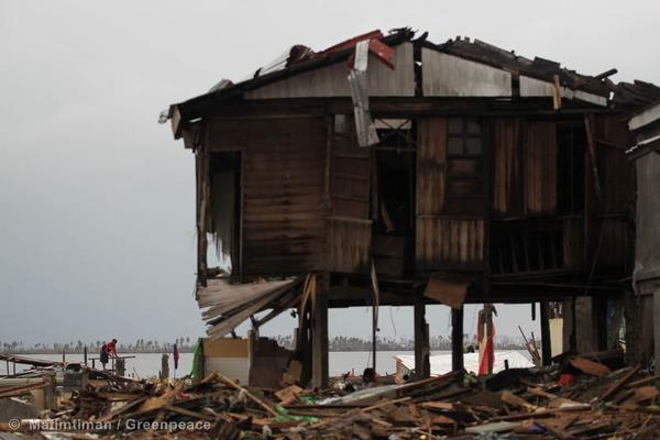 A man looks for salvageable items from buildings destroyed by Typhoon Haiyan