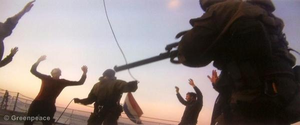 Russian security services abseiling from a helicopter onto the deck of the Arctic Sunrise and seizing the ship