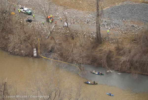 Gray, coal-ash laden water enters the Dan River.