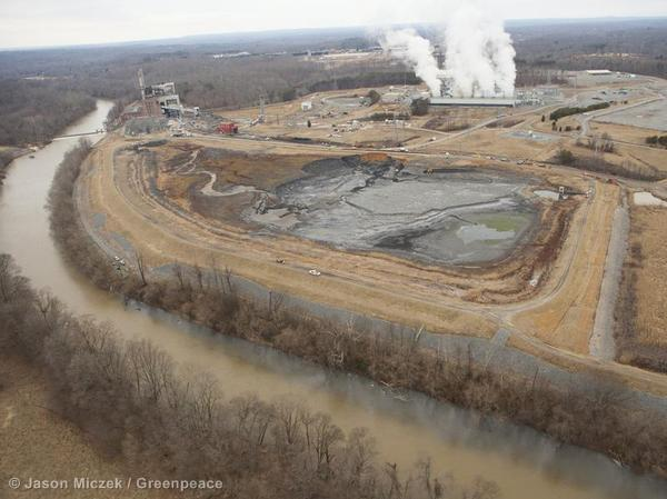 The collapsed unlined coal ash pond between a power plant and the Dan River in Eden, North Carolina.
