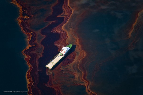 A view from an altitude of 3200 ft of the oil on the sea surface, originated by the leaking of the Deepwater Horizon wellhead disaster. The BP leased oil platform exploded April 20 and sank after burning, leaking an estimate of more than 200,000 gallons of crude oil per day from the broken pipeline into the sea.