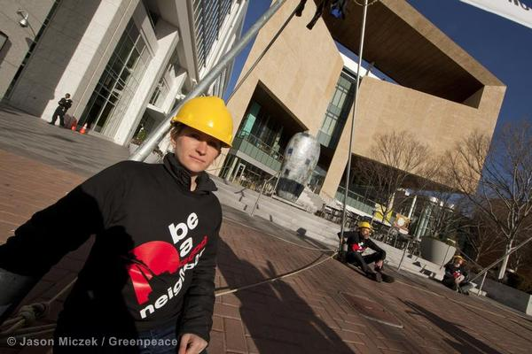 North Carolina Organizer Monica Embrey anchors one leg of a tripod at Duke Energy Center.