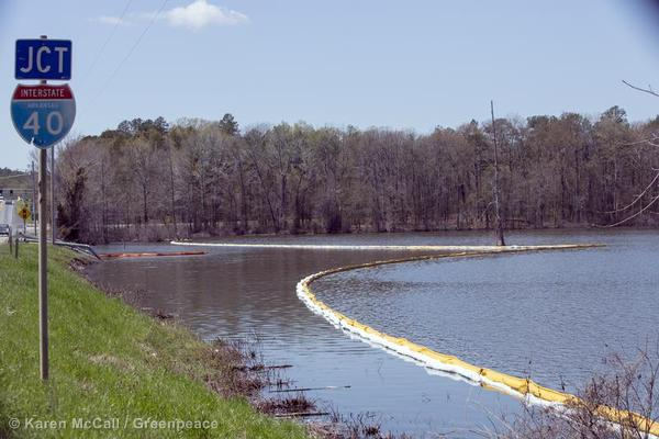 Oil booms are visible in the water alongside Interstate 40 near Mayflower, Arkansas.